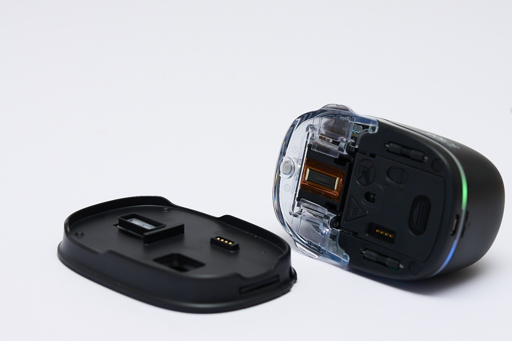 The e-mark handheld inkjet printer's bottom and docking station.