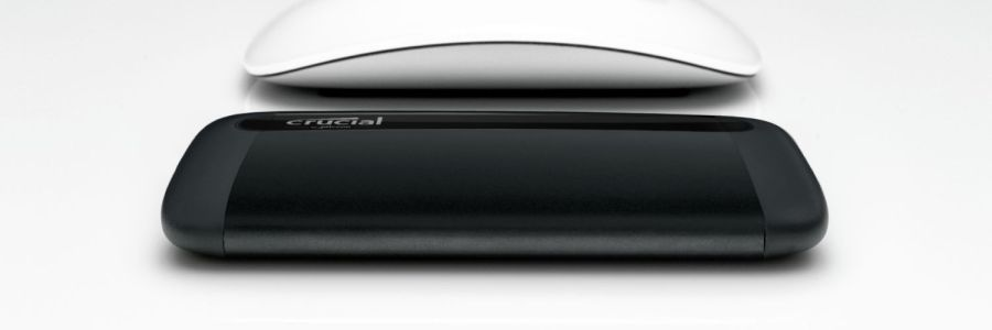 Crucial X8 next to Apple Magic mouse